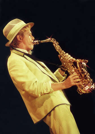 "David Bowie performs on stage playing saxophone on his ""Serious Moonlight"" tour, at Wembley Arena in 1983 in London. Photo: Peter Still, Getty Images / 1983 Peter Still"