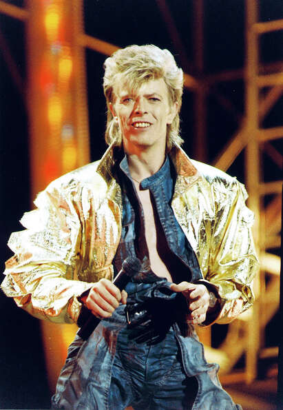 David Bowie performing on stage during the Glass Spider tour in 1987.
