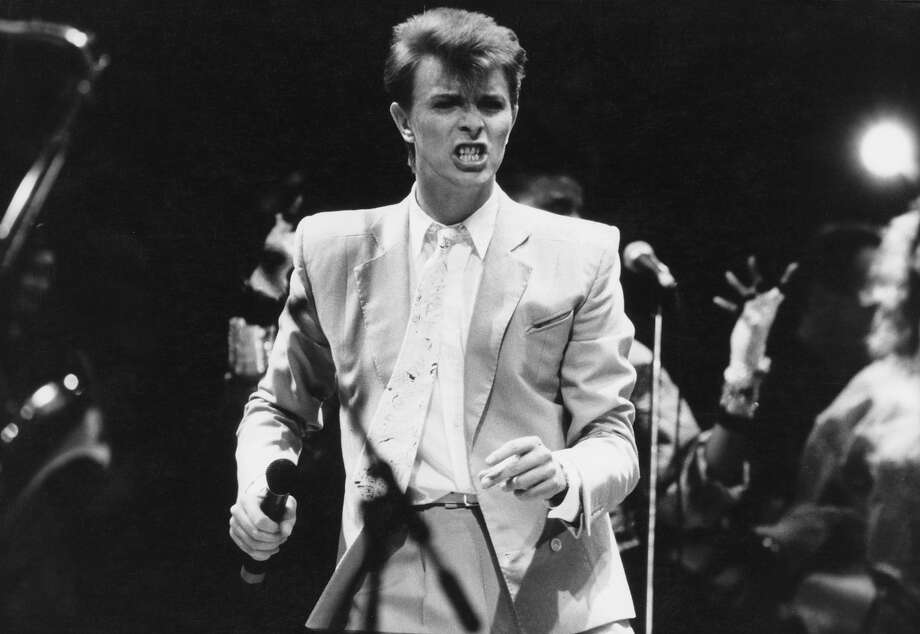 English singer David Bowie performing at the Live Aid concert at Wembley Stadium in London, 1985. The concert raised funds for famine relief in Ethiopia. Photo: Georges DeKeerle, Getty Images / 2011 Georges DeKeerle