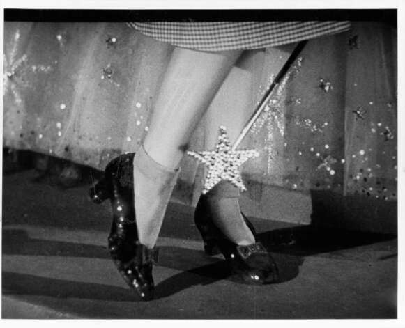 Close up of the ruby slippers on Judy Garland's feet with the tip of Glinda's wand in a scene from the film 'The Wizard Of Oz.' Photo: MGM Studios, Getty Images / 2012 Getty Images