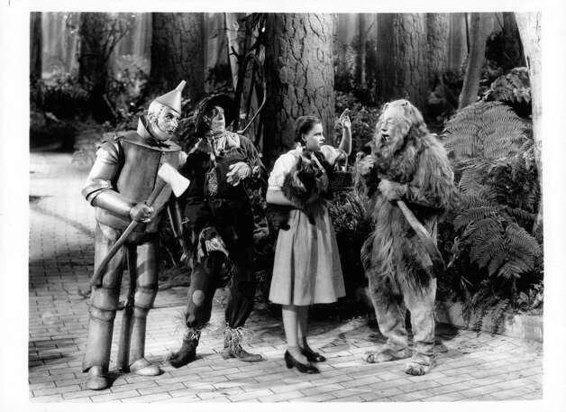 Jack Haley as the Tin Man, Ray Bolger as the Scarecrow, Judy Garland as Dorothy Gale and Bert Lahr as the Cowardly Lion in a scene from the film 'The Wizard Of Oz.' Photo: MGM Studios, Getty Images / 2012 Getty Images