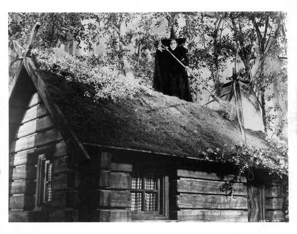 "Margaret Hamilton as the Wicked Witch of the West on top of a roof with her broom in a scene from ""The Wizard Of Oz."" Photo: MGM Studios, Getty Images / 2012 Getty Images"