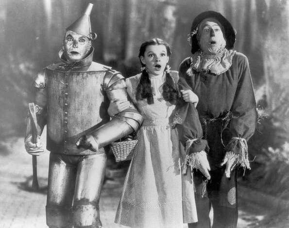 The Tin Man (Jack Haley), Dorothy (Judy Garland) and the Scarecrow (Ray Bolger) set off on their quest for fulfillment in the 'The Wizard of Oz.' Photo: FPG, Getty Images / 2004 Getty Images
