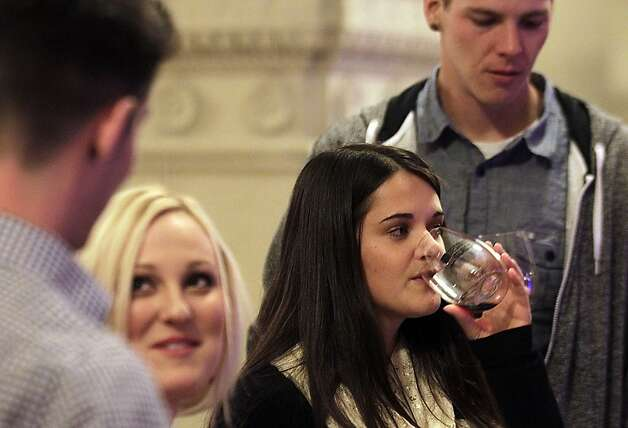 Wine Riot, a wine-tasting event focused on millennials, is helping push wine sales to new records. Events like this one in Los Angeles, California, are being held around the U.S., complete with crash seminars on wine, fake tatoos, deejays and photo booths. (Luis Sinco/Los Angeles Times/MCT) Photo: Luis Sinco, McClatchy-Tribune News Service