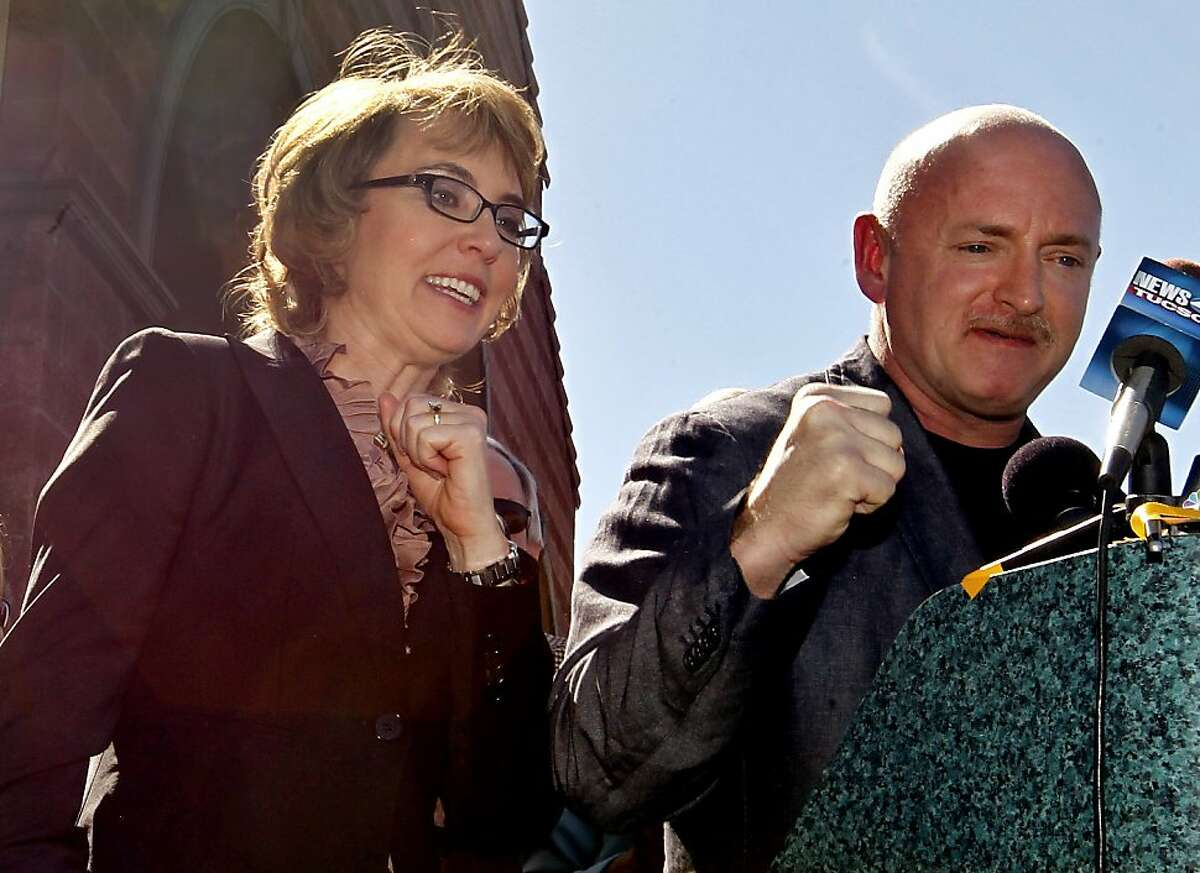 Former Rep. Gabrielle Giffords, left, shouts