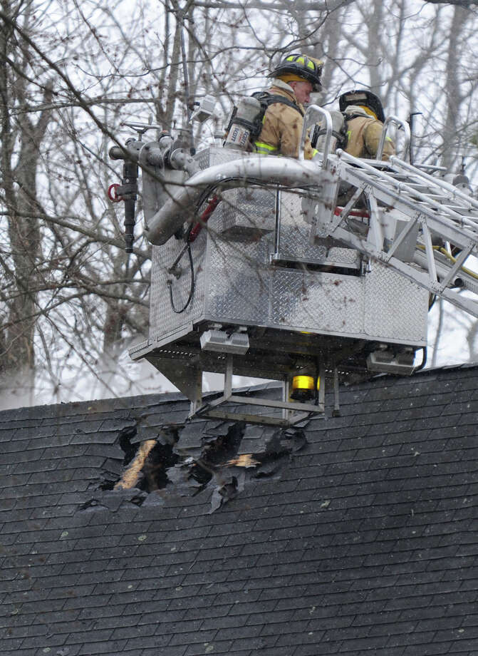 A fire damaged a home on Reservoir Street in Bethel, Conn. Thursday, March 7, 2013. Photo: Carol Kaliff / The News-Times