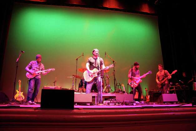 The Mighty Ploughboys perform at The Ridgefield Playhouse on Saturday, March 2. Left to right are John Rich (guitar and vocals), Pat Hearty (lead vocals and acoustic guitar), Renato Ghio (guitar and mandolin), and Sean Finnerty (bass guitar). Photo: Contributed Photo