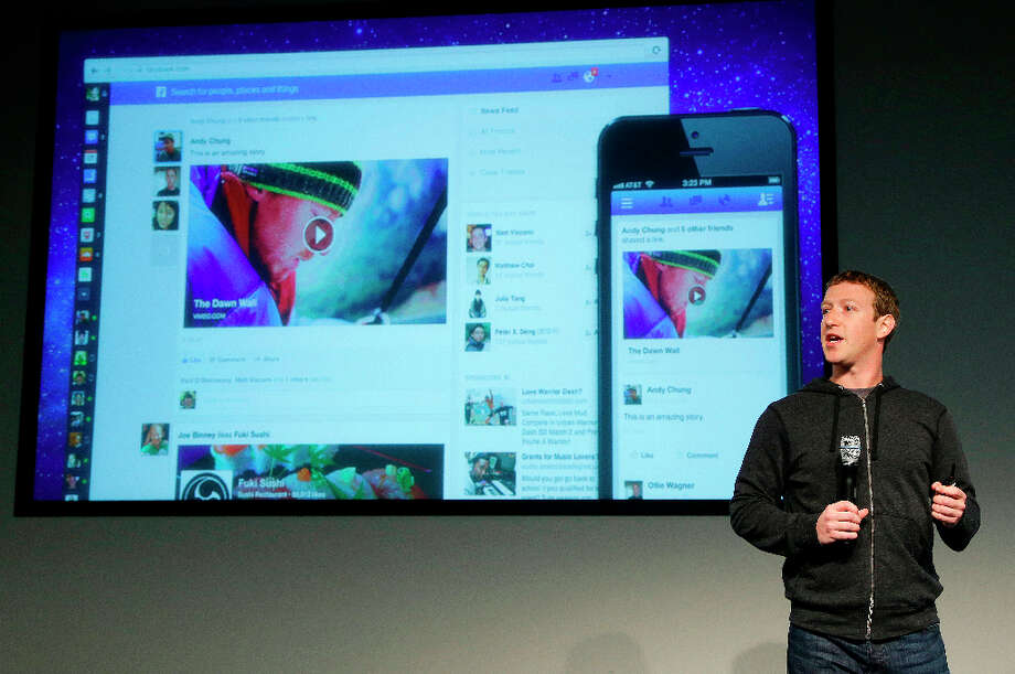 Facebook CEO Mark Zuckerberg speaks at Facebook headquarters in Menlo Park. Zuckerberg unveiled a new look for the social network's News Feed. Photo: Jeff Chiu, Associated Press / AP