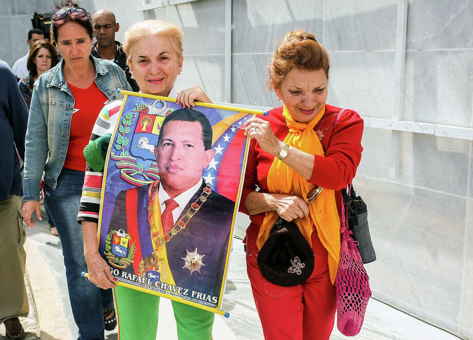 Two women walk in the Revolution Square in Havana after attending the posthumous tribute to late Venezuelan President Hugo Chavez at the Jose Marti Memorial, on March 7, 2013. Chavez's death on March 5 was a blow to his supporters and to the alliance of left-wing Latin American powers he led. Photo: ADALBERTO ROQUE, AFP/Getty Images / 2013 AFP