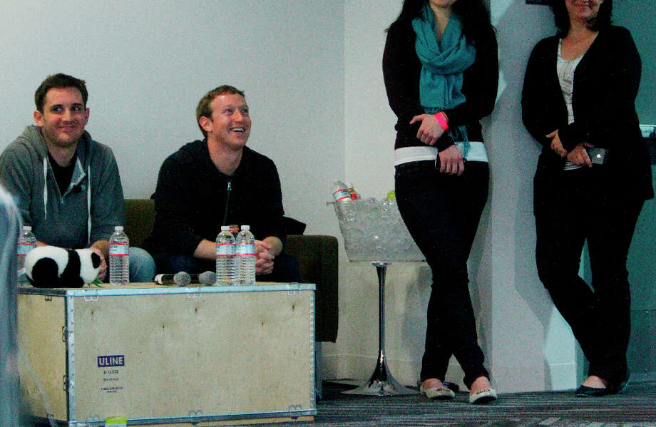Mark Zuckerberg (second from left) sits with Chris Struhar (left), tech lead   as they listen to Julie Zhuo (not shown), director of design speak during a press conference where a redesign of  Facebook's  News Feed was announced at it's headquarters on Thursday, March 7, 2013 in Menlo Park, Calif. Photo: Lea Suzuki, The Chronicle / ONLINE_YES