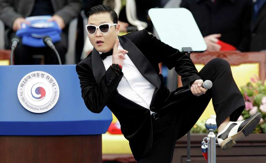 "FILE - In this Feb. 25, 2013 file photo, South Korean rapper PSY performs before President Park Geun-hye's presidential inauguration ceremony at the National Assembly in Seoul, South Korea. Sporting a black suit and a sleek haircut, a 7-year-old boy, Hwang Min-woo performed at a news conference in South Korea on Wednesday, March 6, 2013. The impish boy nicknamed ""Little PSY"" is releasing an electro pop song next week through iTunes. Min-woo says he wants to gain global fame like his ""big brother,"" PSY. (AP Photo/Lee Jin-man, FIle) Photo: Lee Jin-man"