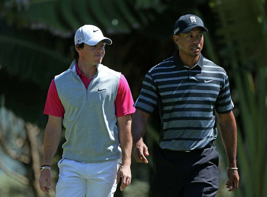 Rory McIlroy (left) and Tiger Woods walk onto the 13th hole during the first round of the WGC-Cadillac Championship at the Trump Doral Golf Resort & Spa in Miami. Photo: Warren Little, Getty Images / 2013 Getty Images