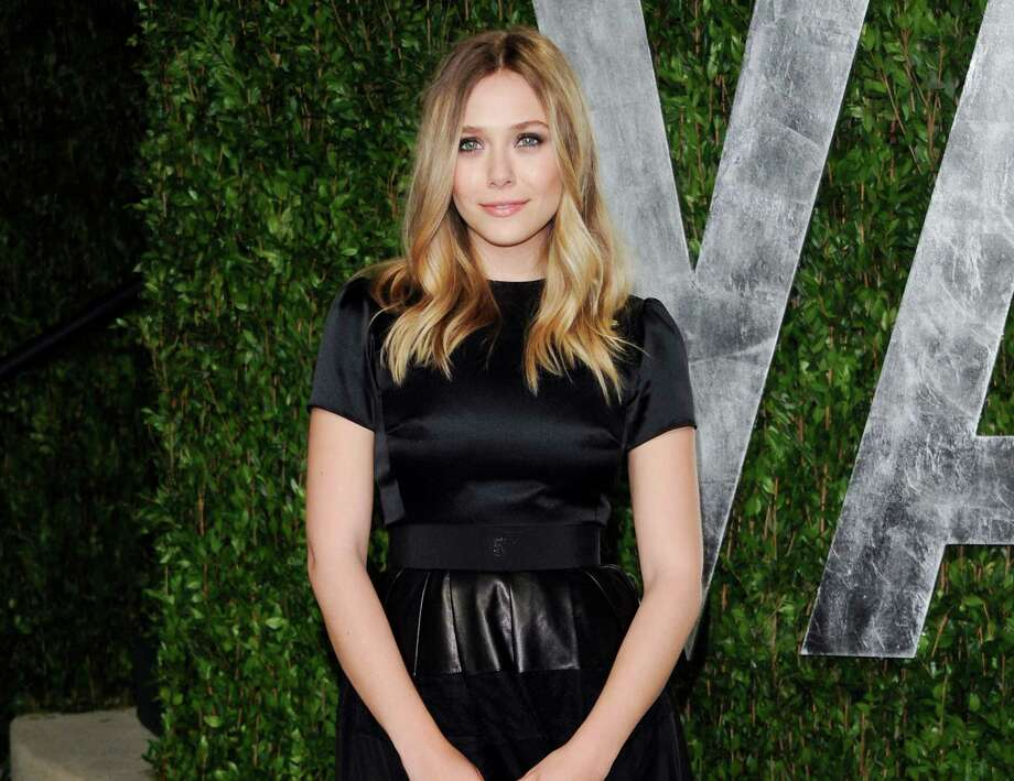 "FILE - This Feb. 26, 2012 file photo shows actress Elizabeth Olsen arrives at the Vanity Fair Oscar party in West Hollywood, Calif. Olsen will soon be a star-crossed lover _ she'll star in an off-Broadway version of Shakespeare's ""Romeo & Juliet."" Classic Stage Company said Thursday that the younger sister of Mary-Kate and Ashley Olsen will help will kick off their 2013/2014 season. (AP Photo/Evan Agostini, file) Photo: Evan Agostini"