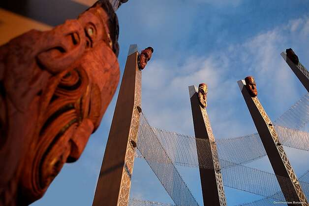 These carved faces and poles mark the site of Te Puia, an impenetrable Maori fortress in Rotorua that used the Whakarewarewa geysers and geothermal activity as a natural hot water moat. In 1963 the New Zealand Maori Arts and Crafts Institute was established on the site, now a popular visitor attraction. Its dramatic setting, history and cultural resources are reminiscent of Pu' Honua 'O Hōnaunau on the island of Hawai'i, a place of refuge that's now a national historical park. Photo: Destination Rotorua