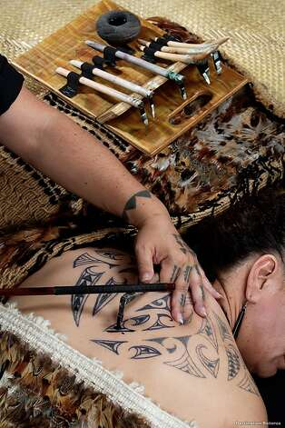 Some ta moko (tattoo) artists such as Henriata Nicholas of Rotorua, work with traditional hand-made chisels fashioned from boar's tusk or albatross bones as they create the deeply personal designs, which often reflect family history and should not be copied. Kirituhi is the name of a form of skin art that uses Maori-styled designs, but is not as spiritual as ta moko. In the Hawaiian Islands, the traditional form of tattooing known as kakau is becoming increasingly popular and has been the subject of recent exhibitions. Photo: Destination Rotorua