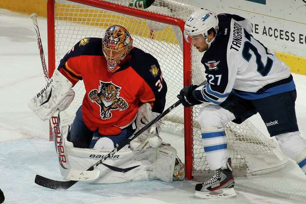SUNRISE, FL - MARCH 5: Goaltender Jacob Markstrom #35 of the Florida Panthers stops a shot by Eric Tangradi #27 of the Winnipeg Jets at the BB&T Center on March 5, 2013 in Sunrise, Florida. The Panthers defeated the Jets 4-1. Photo: Joel Auerbach, Getty Images / 2013 Getty Images