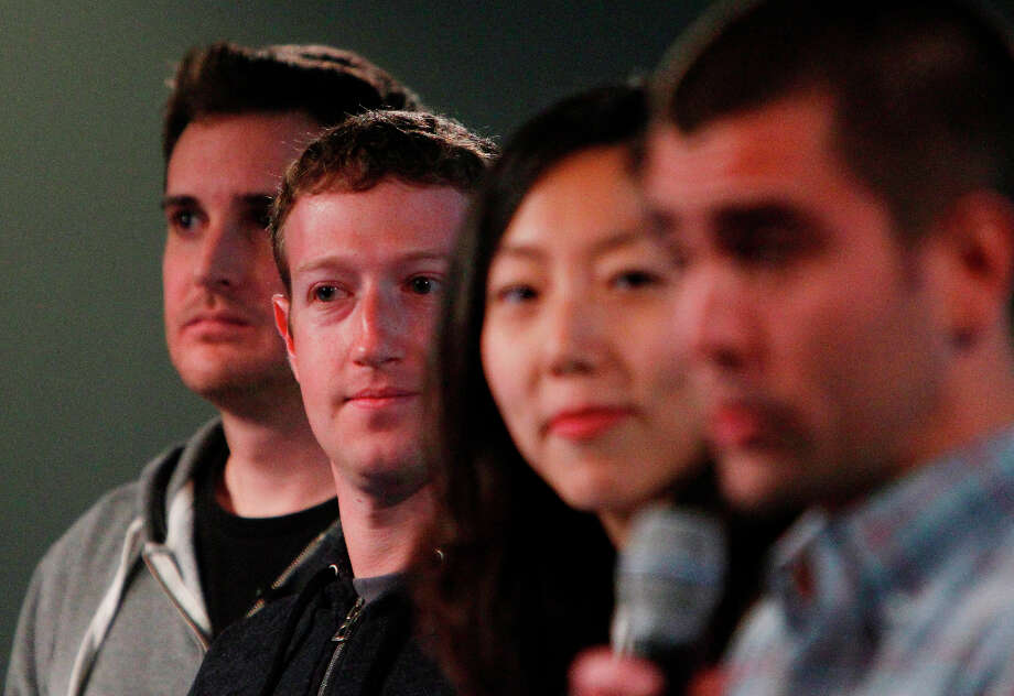 Mark Zuckerberg (second from left) stands with Chris Struhar (left), tech lead and  Julie Zhuo (second from right), director of design as Chris Cox (right), vice president of product speaks during a press conference where a redesign of  Facebook's  News Feed was announced at it's headquarters on Thursday in Menlo Park. Photo: Lea Suzuki, The Chronicle / ONLINE_YES