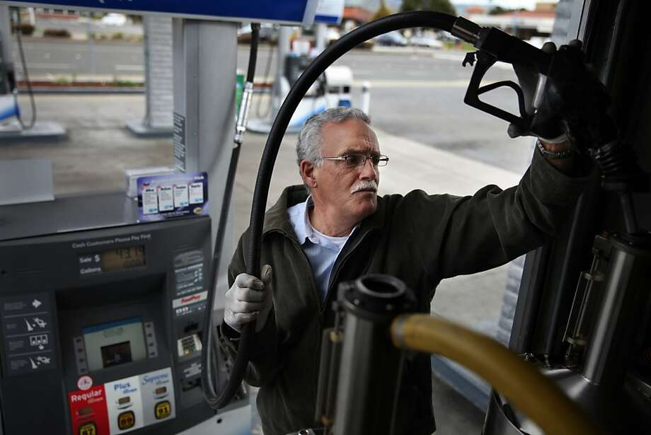 Senior inspector Brent Faria fills a standard with gasoline on March 6, 2013 in Union City, Calif. Photo: Lea Suzuki, The Chronicle