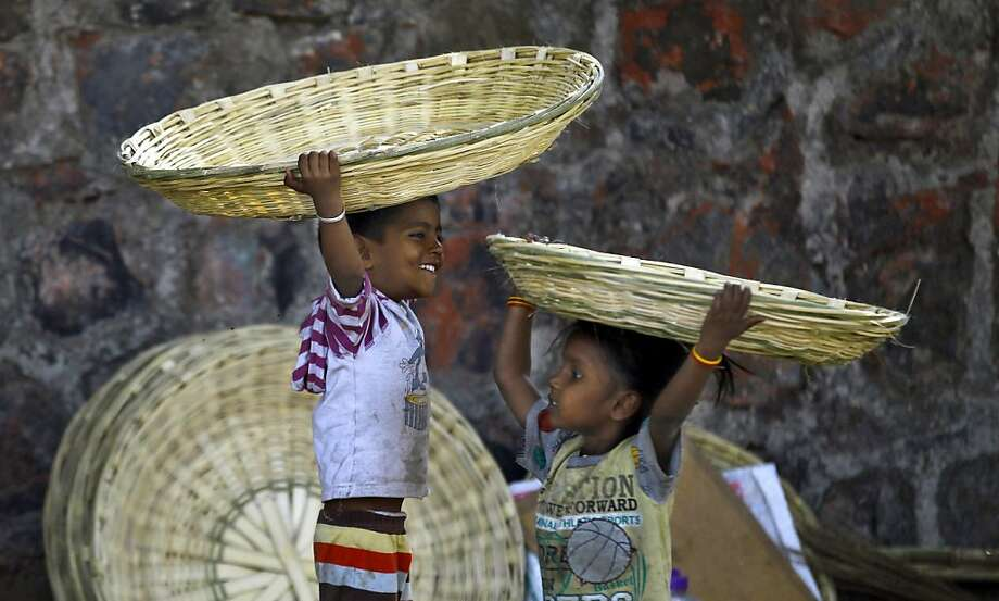 You don't necessarily need sombreros to do the Mexican hat dance. Wicker baskets made by your parents will do in a pinch. (Roadside basket stand in Mumbai, India.) Photo: Rafiq Maqbool, Associated Press