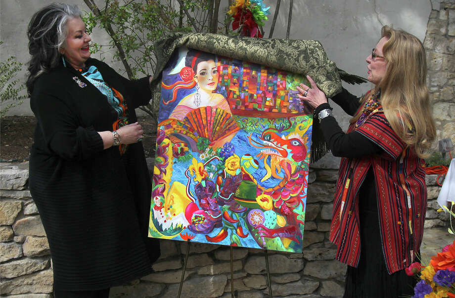 "Artist Debra Benditz (left) and Night In Old San Antonio Chairman Kathy DeWaal (right) unveil the new 2013 NIOSA poster titled ""Cornucopia of Culture"" Thursday March 7, 2013 at La Villita. Created by Benditz, the poster depicts images that represent cultural areas and the history of NIOSA. NIOSA takes place April 23-April 26 from 5:30 to 10:30 p.m. during the city's 11-day Fiesta celebration. Photo: JOHN DAVENPORT, SAN ANTONIO EXPRESS-NEWS / ©San Antonio Express-News/Photo may be sold to the public"