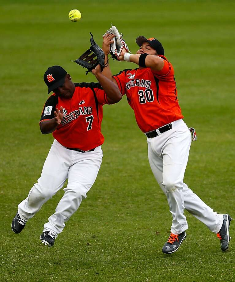 Mine! Mine! Mine! … Yours!Netherlands fielders Osandrick Statia (left) and Eldrick Dijkhof  collide during a Men's World Softball Championships game between Philippines and Netherlands in Auckland, New Zealand. Photo: Simon Watts, Getty Images