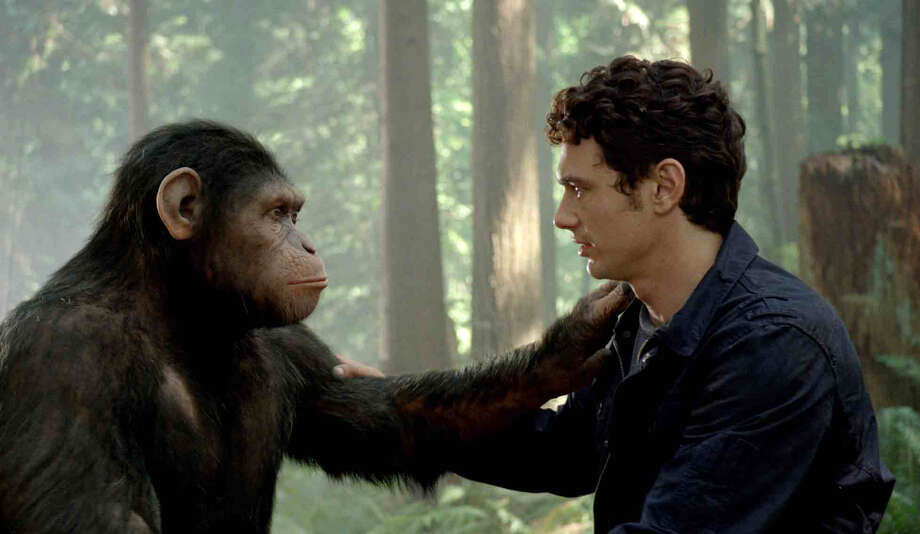 "In this image released by Twentieth Century Fox, Caesar the chimp, a CG animal portrayed by Andy Serkis, and James Franco are shown in a scene from ""Rise of the Planet of the Apes .""  The prequel ""Rise of the Planet of the Apes,"" opening in U.S. theaters Friday, features chimpanzees, gorillas and orangutans crafted through performance-capture. It is the same technology used for the giant gorilla in Peter Jackson's 2005 ""King Kong,"" with the same actor who did Kong, Andy Serkis, playing the lead chimp in the prequel.(AP Photo/Twentieth Century Fox) Photo: WETA Digital / TM and © 2011 Twentieth Century Fox Film Corporation.  All right"