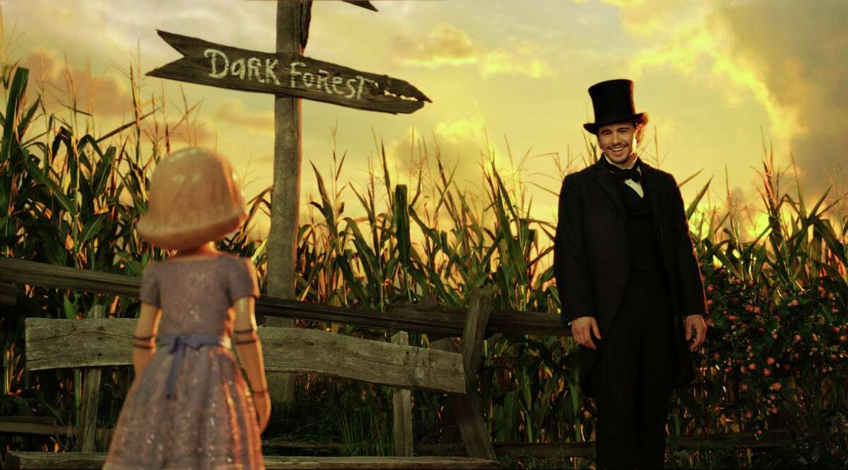 This film image released by Disney Enterprises shows the character China Girl, voiced by Joey King, left, and James Franco, as Oz, in a scene from