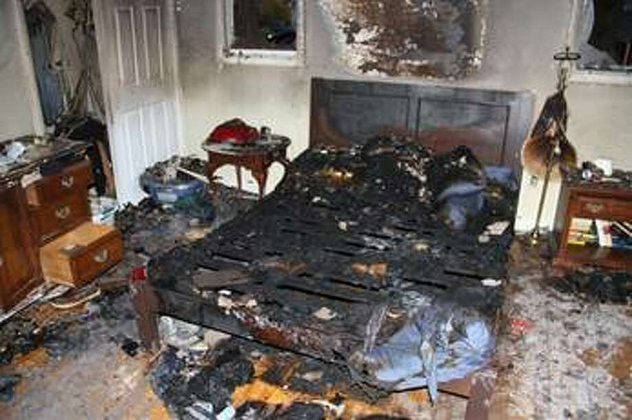 Scene at 96 Elm St. in November 2012 after it was set ablaze by a Troy woman. (photo provided by the Albany County District Attorney's Office)