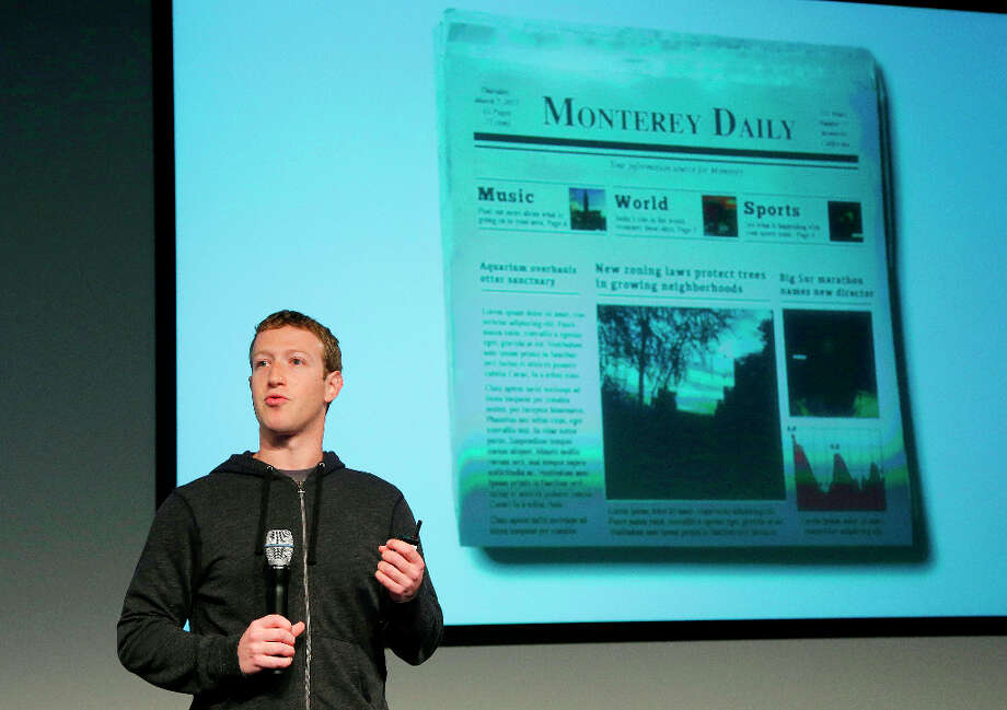 Facebook CEO Mark Zuckerberg unveiled a new look for the social network's News Feed, the place where its 1 billion users congregate to see what's happening with their friends, family and favorite businesses. Photo: Jeff Chiu, Associated Press / AP