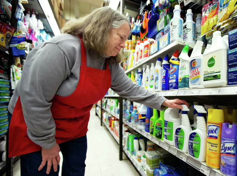 In this Monday, Feb. 25, 2013 photo, Strosnider's Hardware employee Kathie Birenbaum, arranges display of different products to kill mildew in northwest Washington.  Mildew can lead to respiratory problems or other allergic symptoms, health experts says.  (AP Photo/Manuel Balce Ceneta) Photo: Manuel Balce Ceneta