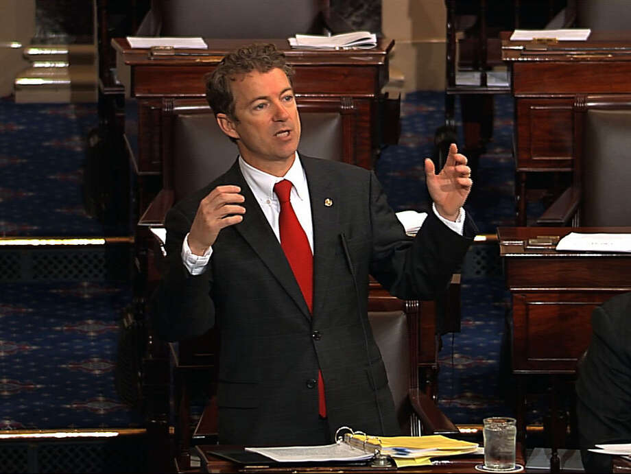 This video frame grab provided by Senate Television shows Sen. Rand Paul, R-Ky. speaking on the floor of the Senate on Capitol Hill in Washington, Wednesday, March 6, 2013. Senate Democrats pushed Wednesday for speedy confirmation of John Brennan's nomination to be CIA director but ran into a snag after a Paul began a lengthy speech over the legality of potential drone strikes on U.S. soil. But Paul stalled the chamber to start what he called a filibuster of Brennan's nomination. Paul's remarks were centered on what he said was the Obama administration's refusal to rule out the possibility of drone strikes inside the United States against American citizens.  (AP Photo/Senate Television) Photo: Associated Press / Senate Television