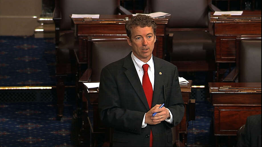 This video frame grab provided by Senate Television shows Sen. Rand Paul, R-Ky. speaking on the floor of the Senate on Capitol Hill in Washington, Wednesday night, March 6, 2013, shortly before 10 p.m. EST. Paul was still going strong with his self-described filibuster blocking confirmation of President Barack Obama's nominee John Brennan to lead the Central Intelligence Agency. (AP Photo/Senate Television) Photo: Uncredited, Associated Press / Senate Television