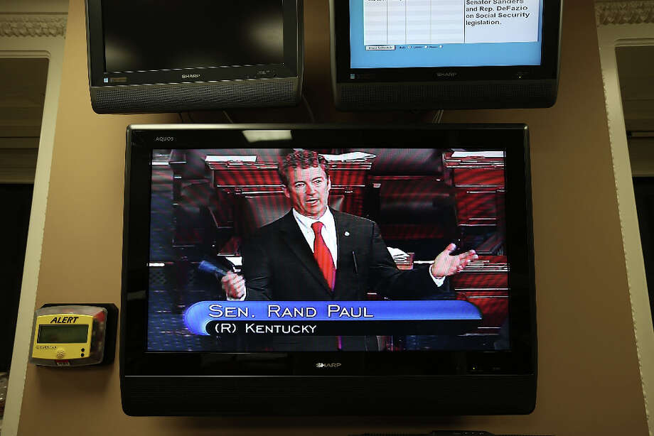 WASHINGTON, DC - MARCH 06:  U.S. Sen. Rand Paul (R-KY) is seen on a TV monitor as he participates in a filibuster on the Senate floor March 6, 2013 on Capitol Hill in Washington, DC. Paul is filibustering the Senate to oppose the nomination of John Brennan to be the next director of CIA. Photo: Alex Wong, Getty Images / 2013 Getty Images