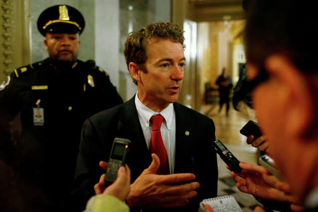 Sen. Rand Paul, R-Ky., talks to reporters as he leaves the floor of the Senate after his filibuster of the nomination of John Brennan to be CIA director on Capitol Hill in Washington, early Thursday, March 7, 2013. Senate Democrats pushed Wednesday for speedy confirmation of John Brennan's nomination to be CIA director but ran into a snag after Paul began a lengthy speech over the legality of potential drone strikes on U.S. soil. But Paul stalled the chamber to start what he called a filibuster of Brennan's nomination. (AP Photo/Charles Dharapak) Photo: Charles Dharapak, Associated Press / AP