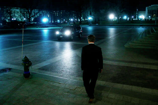 Sen. Rand Paul, R-Ky., walks to a waiting vehicle as he leaves the Capitol after his filibuster of the nomination of John Brennan to be CIA director on Capitol Hill in Washington, early Thursday, March 7, 2013. Senate Democrats pushed Wednesday for speedy confirmation of John Brennan's nomination to be CIA director but ran into a snag after Paul began a lengthy speech over the legality of potential drone strikes on U.S. soil. But Paul stalled the chamber to start what he called a filibuster of Brennan's nomination. (AP Photo/Charles Dharapak) Photo: Charles Dharapak, Associated Press / AP