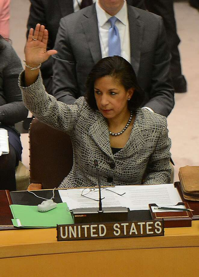 "US Ambassador to the UN Susan Rice votes with UN Security Council members to adopt sanctions against North Korea at the United Nations headquarters in New York, March 7, 2013. North Korea threatened a ""pre-emptive"" nuclear strike against the United States and any other aggressors as the UN Security Council prepared to adopt tough sanctions against the isolated state. AFP PHOTO/EMMANUEL DUNANDEMMANUEL DUNAND/AFP/Getty Images Photo: Emmanuel Dunand, AFP/Getty Images"
