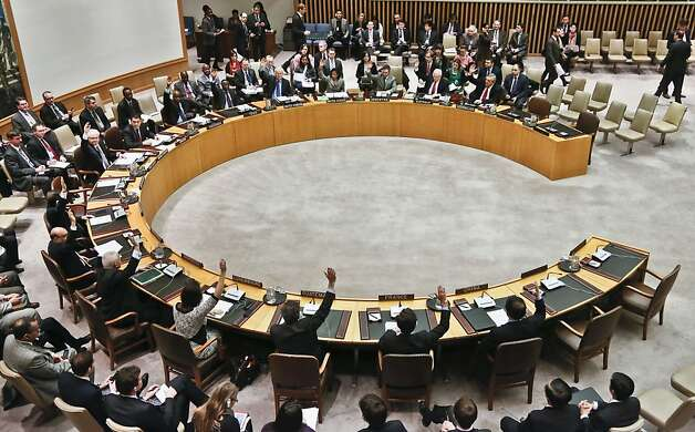 Security Council members vote for tough new sanctions against North Korea for its latest nuclear test, during a meeting at U.N. headquarters Thursday, March 7, 2013. The unanimous vote by the U.N.'s most powerful body sparked a furious Pyongyang to threaten a nuclear strike against the United States. (AP Photo/Bebeto Matthews) Photo: Bebeto Matthews, Associated Press