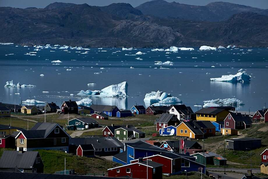 Melting glaciers and icebergs near Narsaq, Greenland, are opening up new opportunities for mining. Photo: Andrew Testa, New York Times