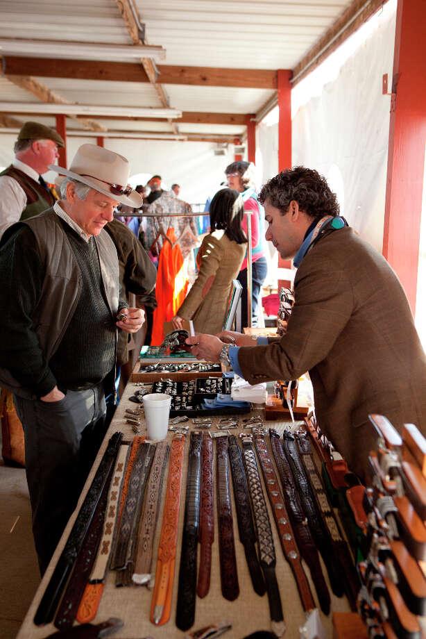 Shopping at vendor Jason Maidas' table. / JennyAntill