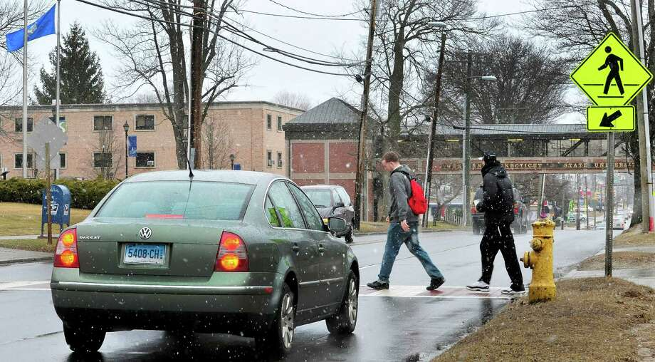 Students cross White Street in Danbury, Conn. near Western Connecticut State University's mid town campus Thursday, March 7, 2013. Photo: Michael Duffy / The News-Times