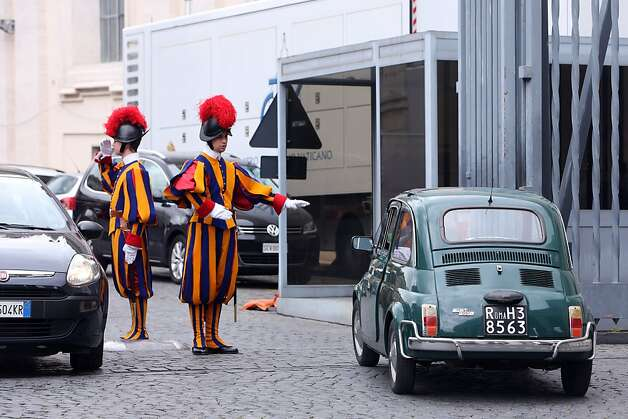 VATICAN CITY, VATICAN - MARCH 07:  A Swiss guard stops a Fiat 500 at the 'Cancello Petriano' at the end of a session of cardinals general congregations on March 7, 2013 in Vatican City, Vatican. There is no indication as yet when a Papal conclave will take place following the resignation of Pope Benedict XVI.  (Photo by Franco Origlia/Getty Images) *** BESTPIX *** Photo: Franco Origlia, Getty Images