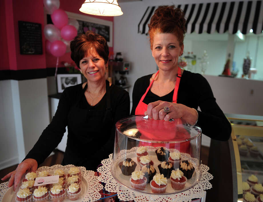 Cousins Darlene Delaney, left, and Sue Schowerer, owners of the new Suzie Cakes specialty cupcake bakery at 107 River Street in Milford, Conn., on Wednesday, March 6, 2013. Photo: Brian A. Pounds / Connecticut Post