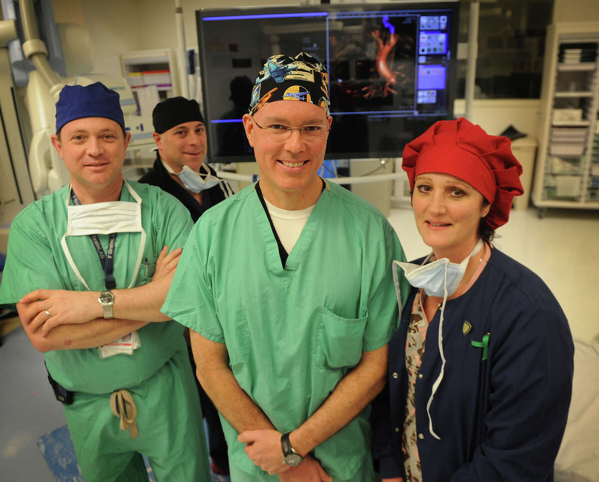 From left; Cardiac anethesiologist Robert Suriani, MD, special procedures technologist Richard Abed, patient safety consultant Joe Brown, and surgical nurse Maryanne O'Connell, RN, in an operating room at St. Vincent's Medical Center in Bridgeport, Conn., on Thursday, March 7, 2013. Brown, an airline pilot, has organized operating room procedures as project manager of the hospital's TAVR initiative.