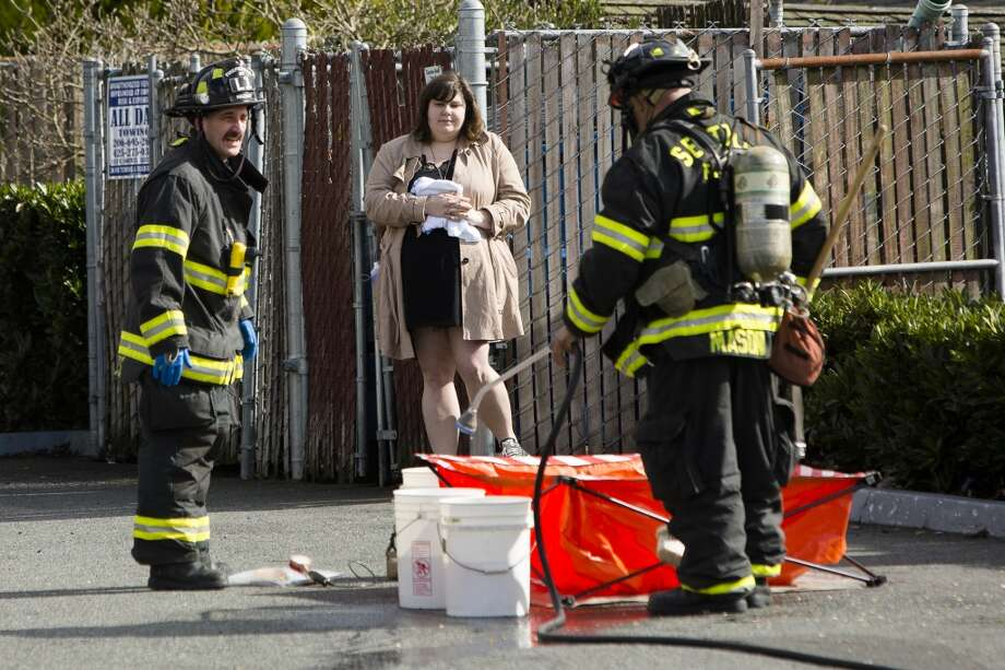 Seattle police and firefighters respond to a hazardous materials incident involving an envelope of powder on Thursday, March, 7, 2013, found near Rain City Video on 8th Avenue Northwest in Ballard. The situation was controlled and the powder declared not dangerous. No injuries were reported.