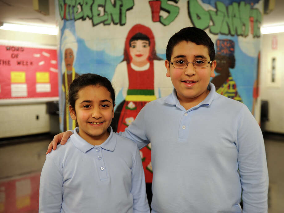 Siblings Natilie Mikhaeel, 8, and Abram Mikhaeel Goda, 12, students at Multicultural Magnet School in Bridgeport, are entered in the East Regional Spelling Bee at Western Connecticut State University in Danbury on March 14. Photo: Brian A. Pounds / Connecticut Post
