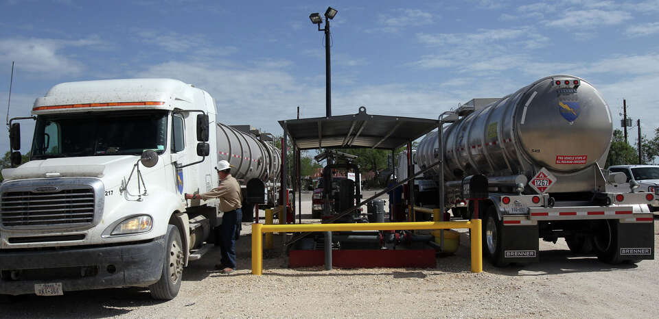 Oil is unloaded from tanker trucks where it will be refined at the Valero Three Rivers refinery in T