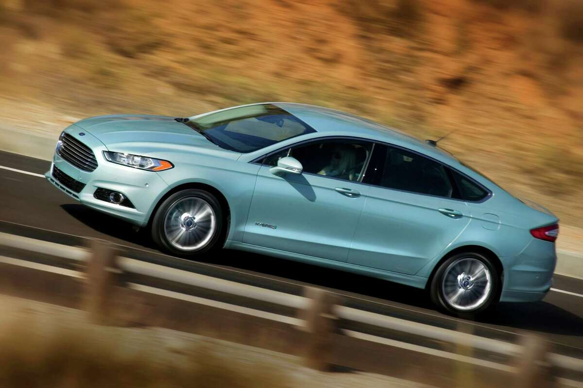 The 2013 Ford Fusion Hybrid is rated at a class-leading 47 mpg in the city and on the highway. The car has sophisticated hybrid technology, but customer satisfaction may be hindered by electronic glitches with its safety systems.
