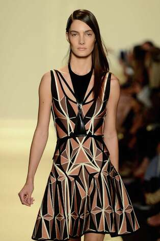 A model walks the runway at the Herve Leger By Max Azria Spring 2013 fashion show during Mercedes-Benz Fashion Week at The Theatre, Lincoln Center on September 8, 2012 in New York City. Photo: Frazer Harrison, Getty Images For Mercedes-Benz F / 2012 Getty Images