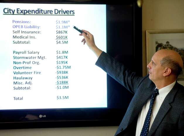 Pete Privitera, Director of the Office of Policy Management, points to a slide during Mayor Michael Pavia's budget proposal for fiscal years 2013-2014 on Thursday, March 7, 2013. Photo: Lindsay Perry / Stamford Advocate