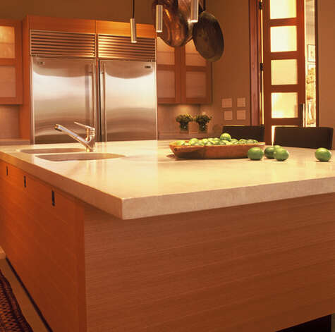 Concrete provides a durable kitchen work surface, and it can look rustic or be polished to a high-gloss finish almost like glass. Photo: Courtesy Buddy Rhodes Studio